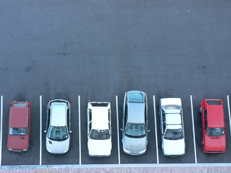 Birds-Eye View of Cars Parked in a Lot